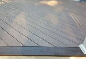 Wolf PVC Decking- Weathered Ipe field with Black Walnut border