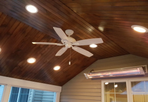 Clipped Cathedral Ceiling with Stained Pine Beadboard Ceiling and Recessed Lighting and Fan. Wall mount Infrared Heater to extend teh season!!!